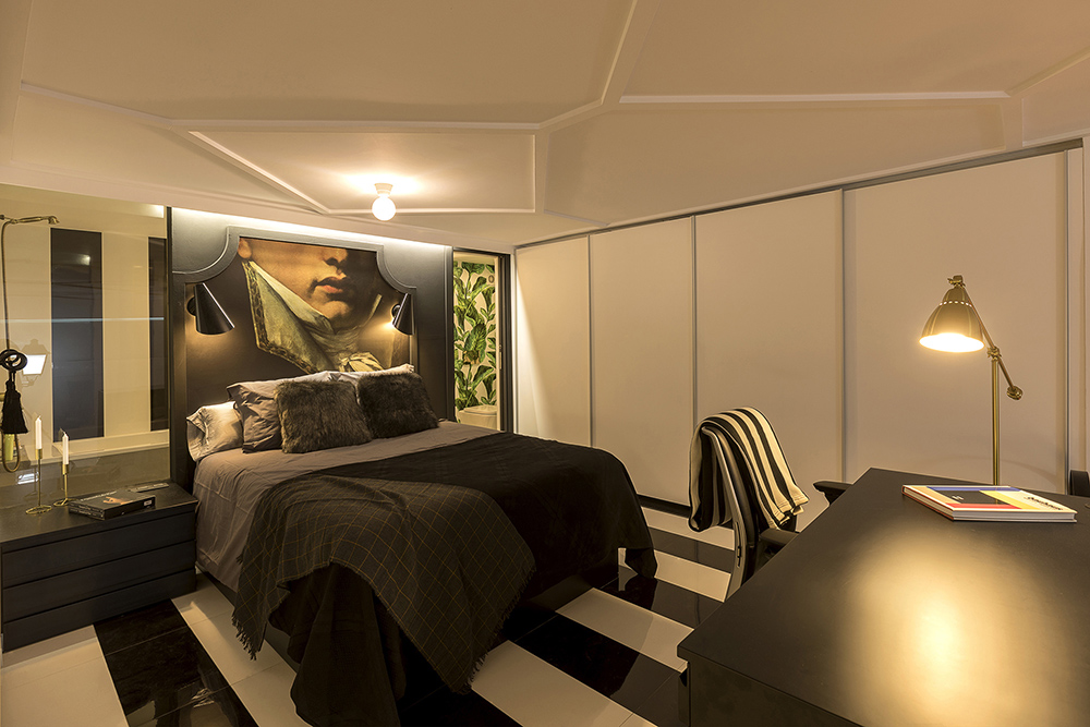 diseño-dormitorio-vestidor-estilo-masculino-cuadro-cabecero-tiovivo